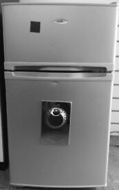 Silver small fridge with karge freezer compartment