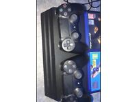 PS4 pro 2 DualShock controllers and 7 games