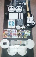 Nintendo wii with guitar hero, 6 games and all conponents