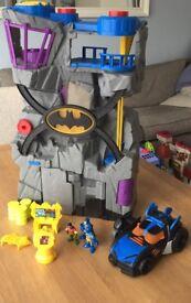 Imaginext batcave with batmobile, bike and batman and robin figure