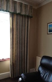 Pair of large lined curtains with valance.