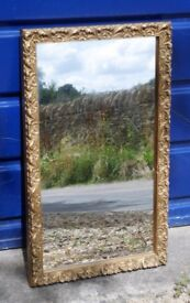 Small gilt-framed mirror for wall-mounting