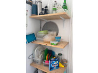 3 wooden shelves on L-brackets
