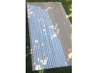 Hockey stick hardwood beading , 34.8 linear metres , primed white .