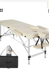 White portable massage table