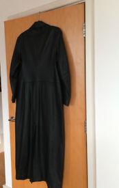 Women's full-length vintage black leather coat