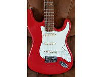 Stratocaster guitar with Fender decals.