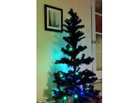 6ft Black plastic Christmas tree with lights and decorations