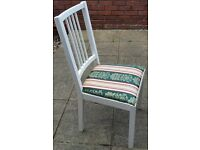 one wooden dining chair with cushioned seat. In good condition.