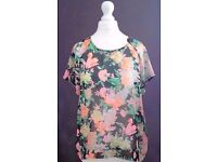 New Chiffon Look Black Floral Sheer Short Sleeve Top with Long Tail Back.Size 12.