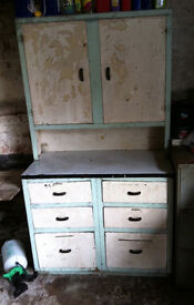 Vintage steel industrial unit with two cupboards over a six drawer base unit