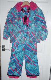 Girls Crushr Tribe ski jacket and matching salopettes