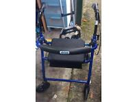 Zimmer frame walking aid with seat and storage folds up