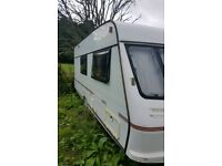 Touring caravan sleeps 8 ready to go