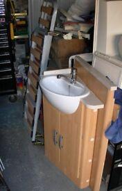 Corner wash basin and cupboard.