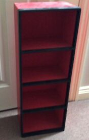 Red and black cd/dvd/toy storage unit