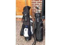 2 sets of right handed golf clubs with bags.
