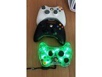 Three Xbox 360 controllers