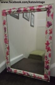 large mirror with hand decorated wooden frame