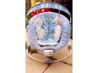 Baby blue vibrating and singing chair