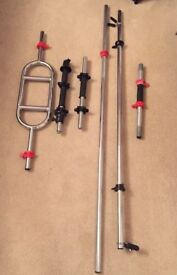 Large collection of assorted weightlifting bars, barbells, & dumbells with stand good condition