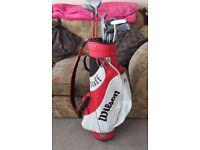 Set of wilson / John Daley golf clubs and bag