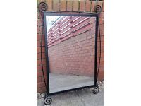 large wall mirror in black metal frame, 64cm x 88cm. In very good condition.