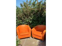 Pair of orange tub chairs