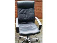faux leather office chair, gas-lift seat height adjust. high backrest. In good condition.