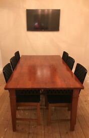 Must See - Solid dark wood table and 8 chairs