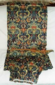 Curtains fully lined with tie backs.