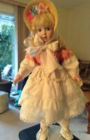 Blonde doll with straw bonnet