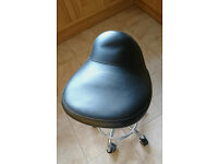 Therepist stool on wheels . Adjustable and well padded - used