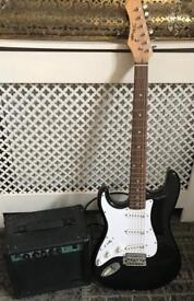 Fender stagg black and white electric guitar and amp