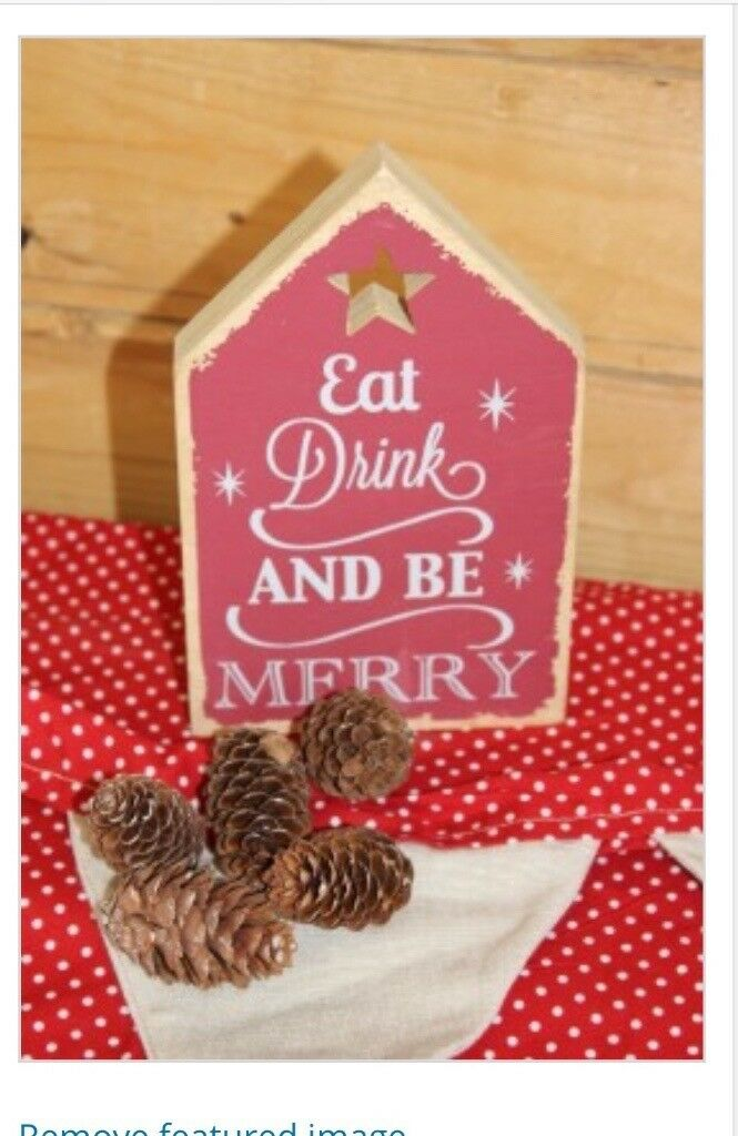 Wooden eat drink and be merry Christmas plaque.