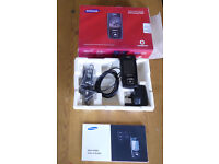 Samsung SGH - E900 flip phone plus charger and headphones.