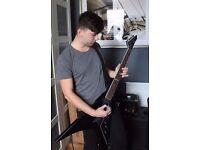 Rhythm guitarist looking Drummer/Bassist to start a band