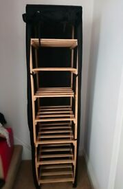 Tall Wooden storage shelves unit with black polycotton cover