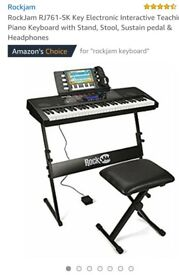 Rockjam Teaching Keyboard. Like new. Still have original packaging. Set up and tested. As new.