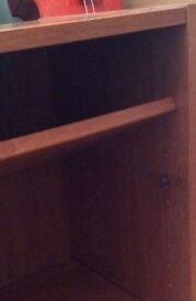 Dark wood vaneer bookcase.