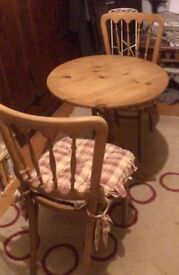 Oak bistro table and two chairs