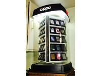 Collection of 60 Brand New Zippo lighters and original fully working lighting display.
