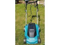 Makita ELM 3310 Rotary Electric Lawn Mower.