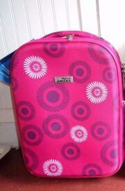New unused cabin suitcase with tags. Pink hand luggage