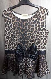 Lady's leopard print bow peplum Skater top