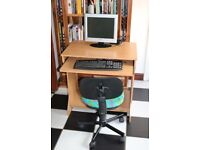 Computer table with kids swivel chair.