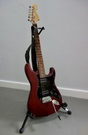 Squier Stratocaster electric guitar, Roland Cube 15 Amp, gig bag, stand, lead & strap bundle