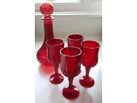 Red decanter with four glasses
