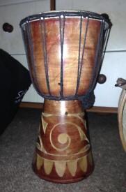 Carved wooden bongo drum