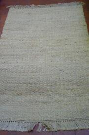 beautiful jute rug made by Pottery Barn